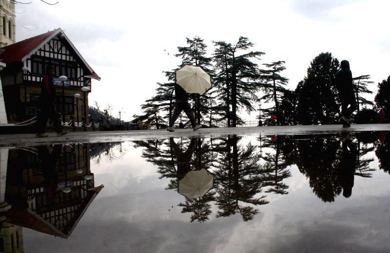 Water gets accumulated on the roadside after heavy rainfalls lash Shimla on Feb 20, 2015.