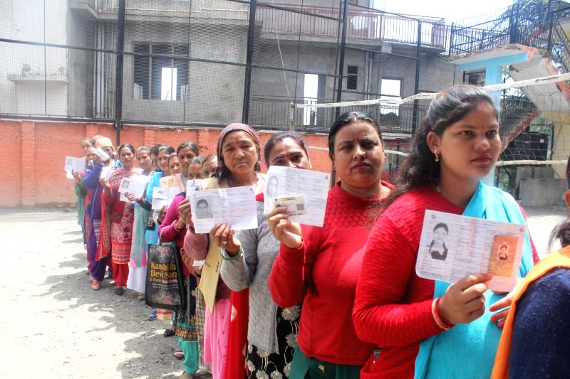Shimla: Women queue-up to cast their votes during the seventh and the last phase of 2019 Lok Sabha Elections at a polling booth in Shimla on May 19, 2019. (Photo: IANS)