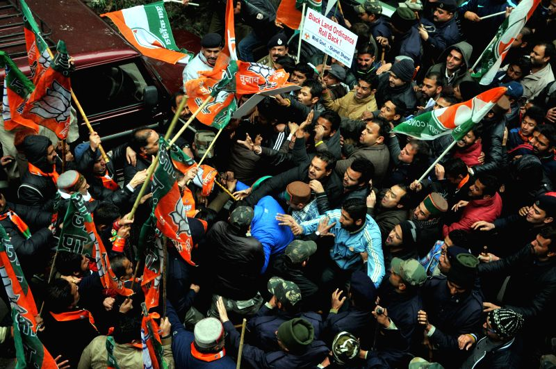 Youth Congress activists clash with memebrs of BJP youth wing during a protest at Chakkar in Shimla on Jan. 29, 2015.