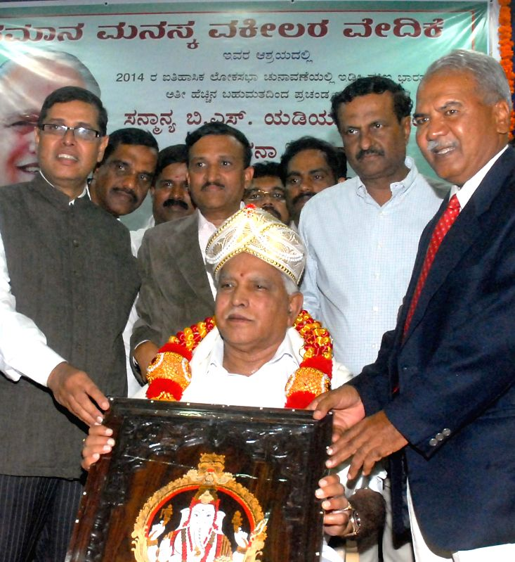 Shimoga MP and BJP leader B S Yeddyurappa being felicitated by Advocates' Forum in Bangalore on June 27, 2014.