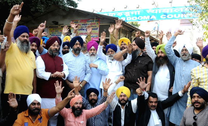 Shiromani Akali Dal (SAD) activists led by party`s Delhi unit chief and Delhi Sikh Gurdwara Management Committee (DSGMC) president Manjit Singh G K stage a demonstration outside the ...