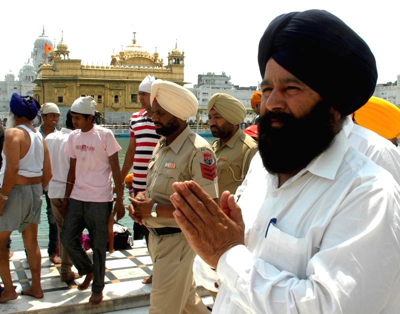 Shiromani Akali Dal (SAD) leader Sher Singh Ghubhaya pays obeisance at the Golden Temple after winning from Firozpur Lok Sabha seat, in Amritsar on May 18, 2014.