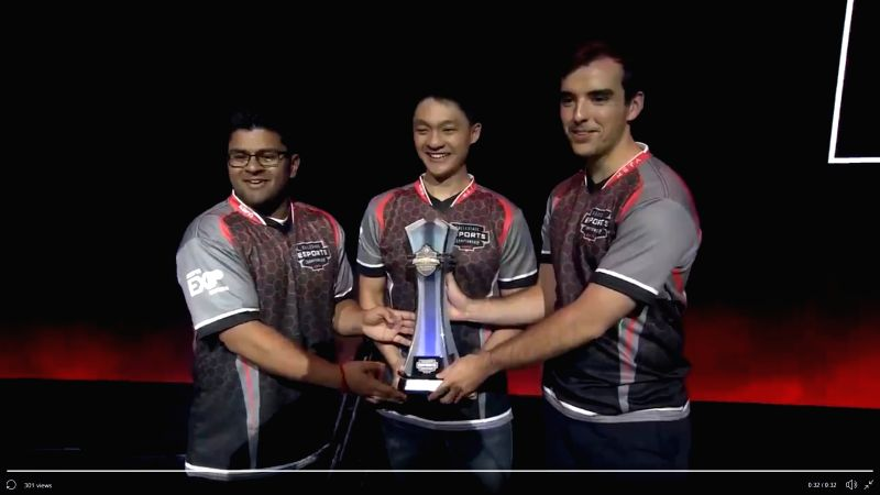 Shiv Chopra (left) with teammates sporting the trophy.