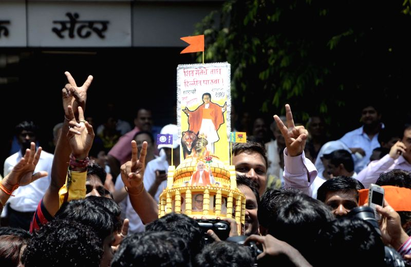 Shiv Sena activists celebrate their performance in 2014 Lok Sabha polls in Mumbai on May 16, 2014.
