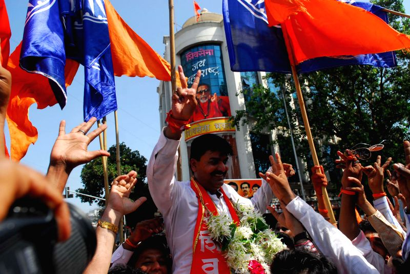 Shiv Sena candidate from South Central Mumbai, Rahul Shewale celebrates his victory with his party workers in Mumbai on May 16, 2014.