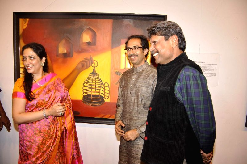 Shiv Sena chief Uddhav Thackeray along with his wife Rashmi Thackeray and Former Indian cricket captain Kapil Dev during the inauguration of art exhibition Divinity by artist Dr Archana Srivastava in - Kapil Dev