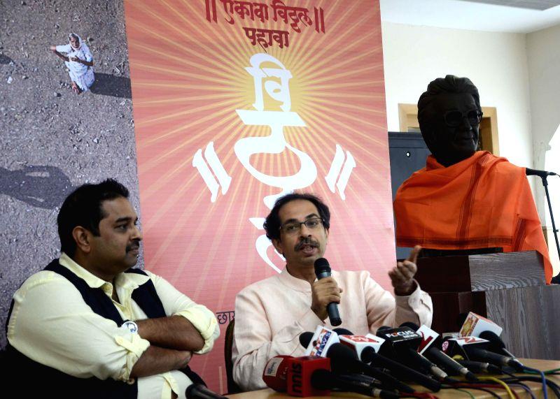 Shiv Sena chief Uddhav Thackeray and singer Shankar Mahadevan during a press conference in Mumbai on July 8, 2014.