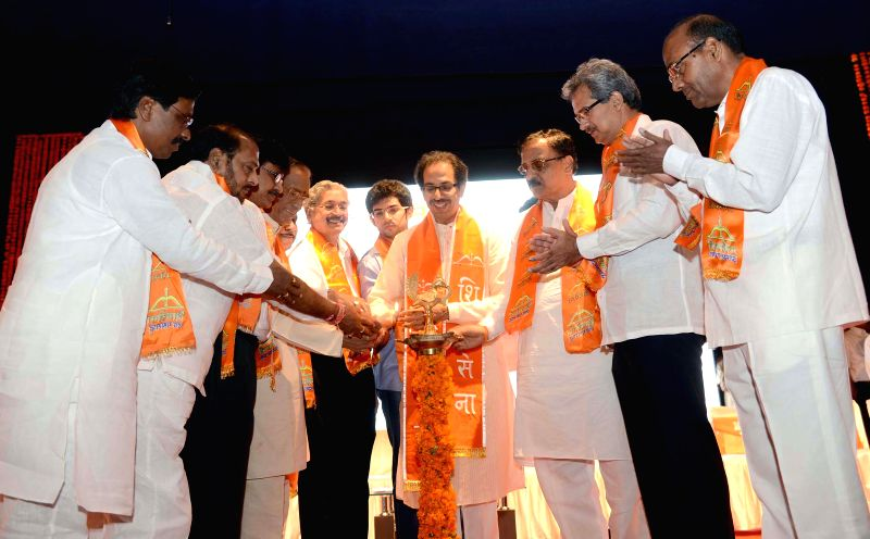 Shiv Sena chief Uddhav Thackeray with Yuva Sena Chief Aditya Thackeray and others during inauguration of a programme in Mumbai on June 18, 2014.