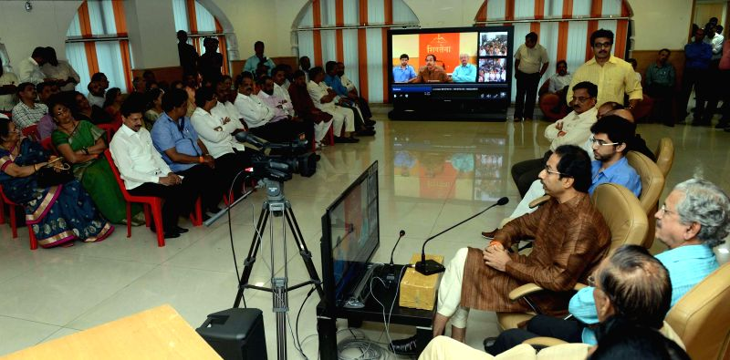 Shiv Sena chief Uddhav Thackeray with Yuva Sena Chief Aditya Thackeray and others during launch of virtual connectivity of district party offices in Mumbai on Aug 7, 2014.