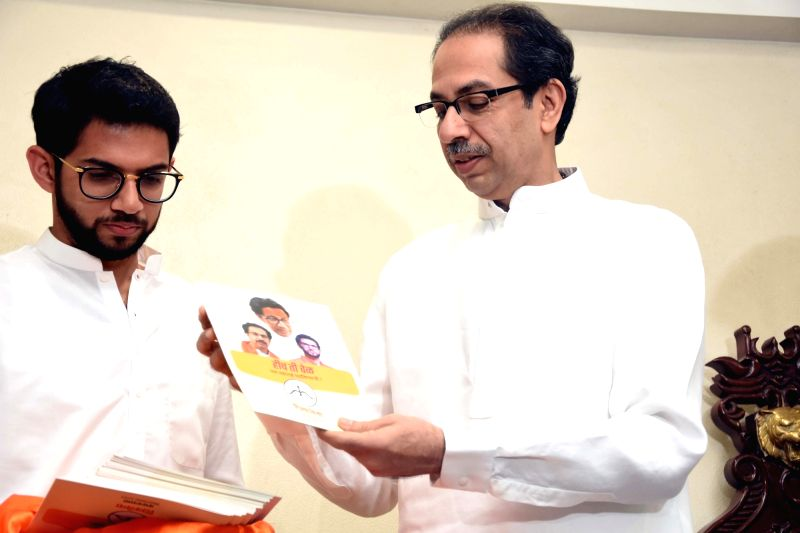 Shiv Sena leaders Uddhav Thackeray and Aditya Thackeray release their party's election manifesto for the upcoming Maharashtra Assembly polls, in Mumbai on Oct 12, 2019. (Photo: IANS)