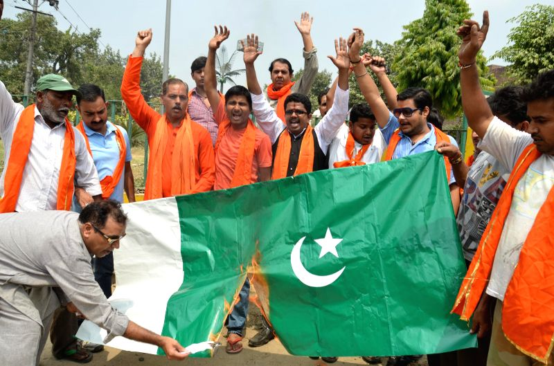 Shiv Sena (Samajwadi) activists demonstrate against for violating ceasefire in Jammu and Kashmir, in Amritsar on Aug 24, 2014.