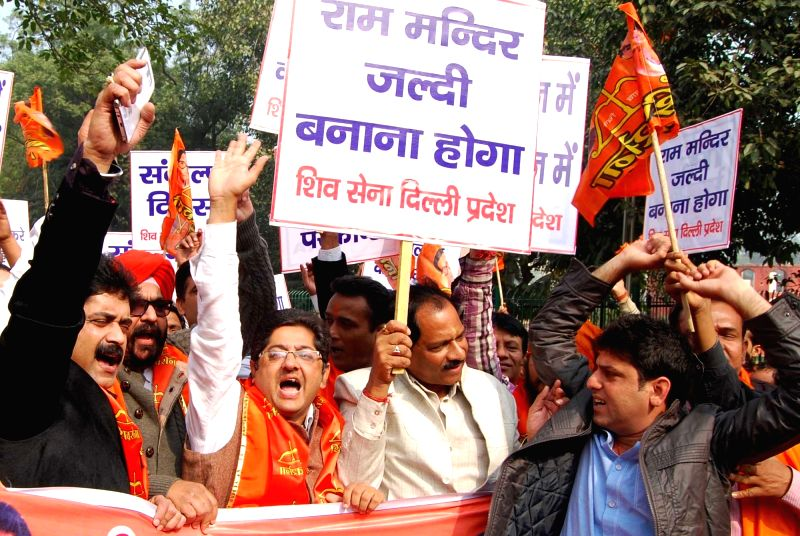 Shiv Sena workers stage a demonstration in New Delhi, on Dec 6, 2015.
