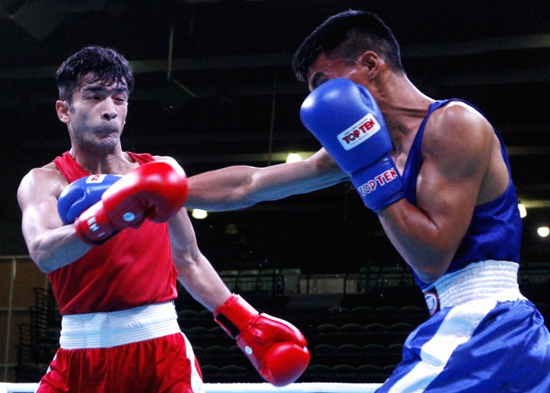 Shiva Thapa (Red) of India in action against Dorji Wangdi of Bhutan during the 1st India Open international boxing tournament in New Delhi, on Jan 29, 2018.