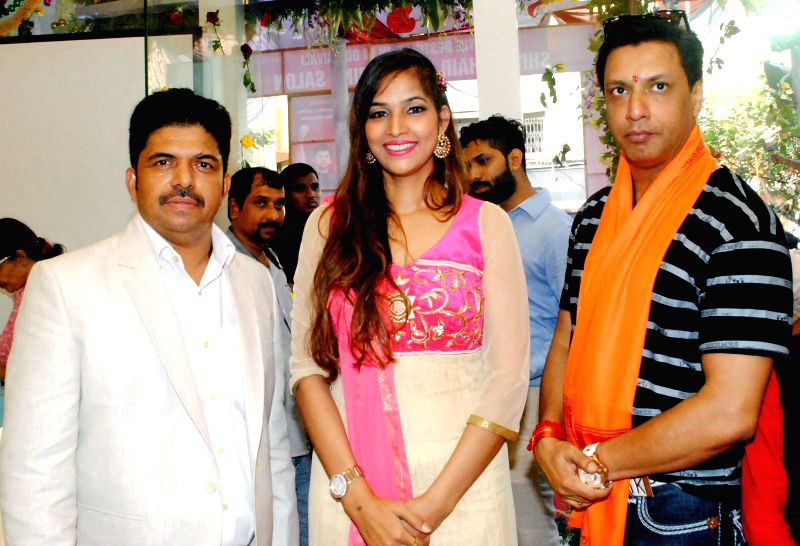 Shivarama Bhandary,Tanisha Singh and Madhur Bhandarkar during the opened Shivarama K Bhandary`s sixth hair design saloon in Mumbai on June 30, 2014. - Tanisha Singh