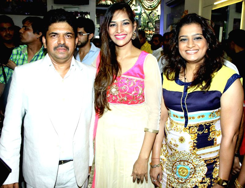 Shivarama,Tanisha and Ekta Jain during the opened Shivarama K Bhandary`s sixth hair design saloon in Mumbai on June 30, 2014. - Ekta Jain