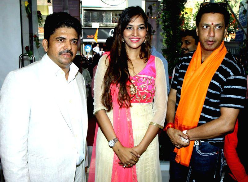Shivarama,Tanisha Singh and Madhur Bhandarkar during the opened Shivarama K Bhandary`s sixth hair design saloon in Mumbai on June 30, 2014. - Tanisha Singh