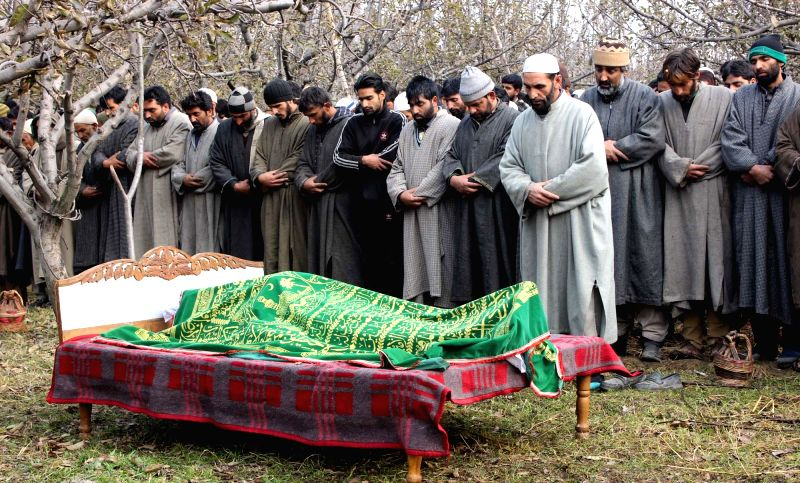 People participate in the funeral of National Conference Sarpanch Mohammad Sultan Bhat, who was shot dead by unidentified persons in Shopian district of Jammu and Kashmir Sunday (30th ...