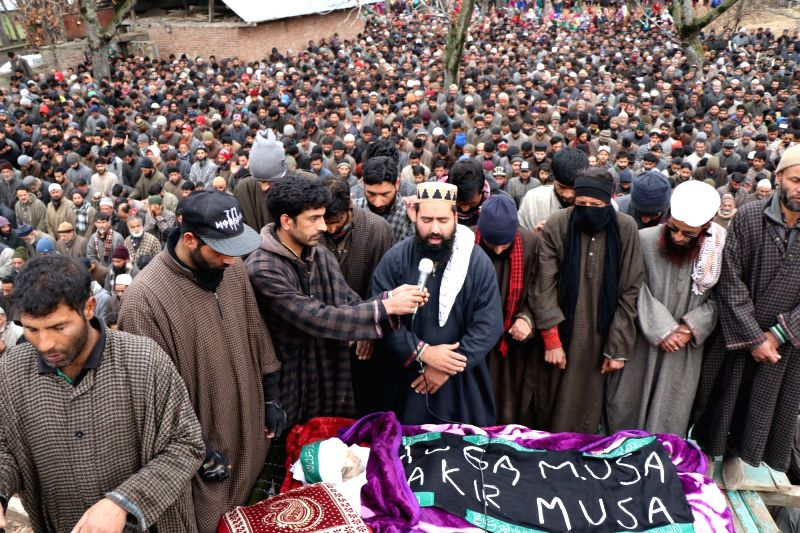 : Shopian: People participate in the funeral procession of a 10-year-old boy who got injured in an explosion at the site of a gunfight and later succumbed to his injuries; in Shopian District in ...