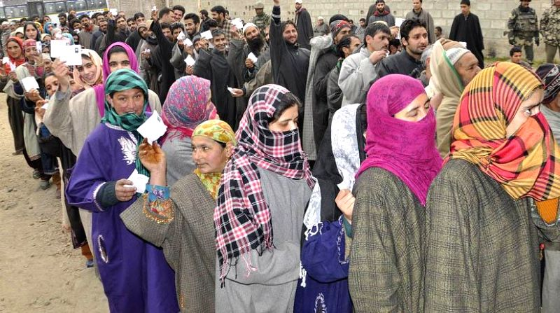 People queue-up to cast their votes during the fourth phase of Jammu and Kashmir assembly polls in Shopian on Dec 14, 2014.