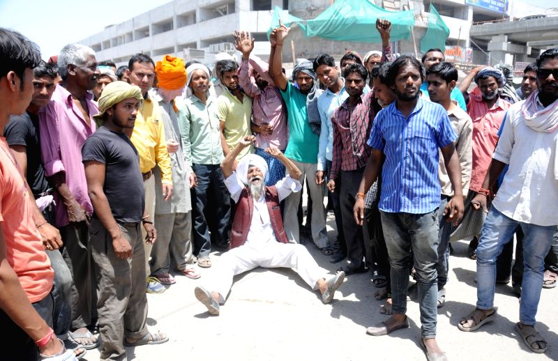 Shopkeepers stage a demonstration to press for their demand in Amritsar, on May 25, 2016.