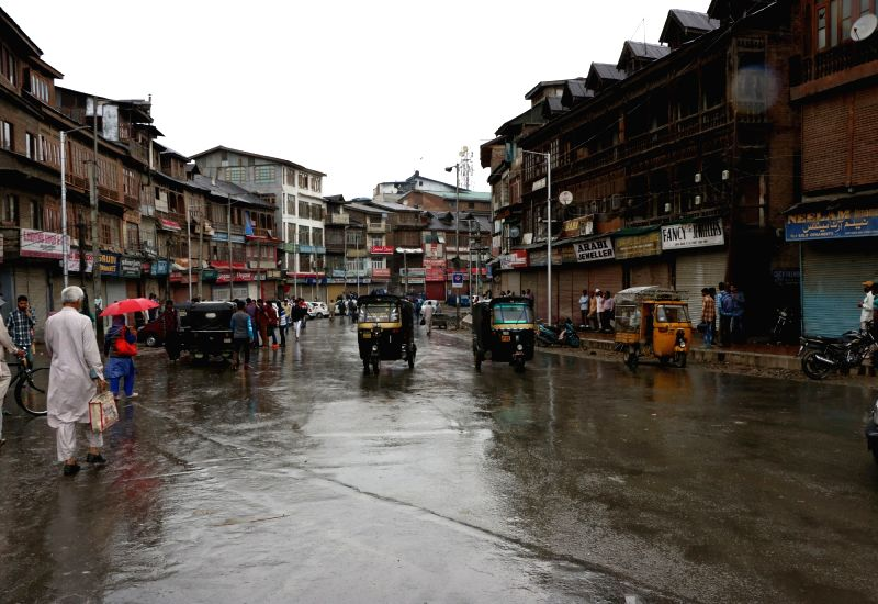 Shops down their shutter as separatists call strike in Srinagar to protest against gunning down of two militants by the security forces in a late night operation on May 24, 2016.