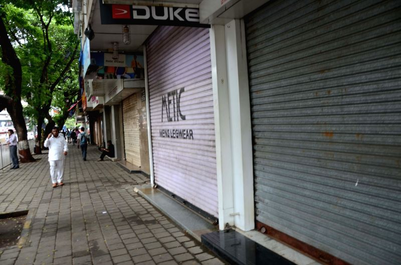 Shops remain closed during Maharashtra shutdown, in Mumbai on July 25, 2018. Large groups of Maratha activists armed with saffron flags and banners, took to the streets with noisy processions ...