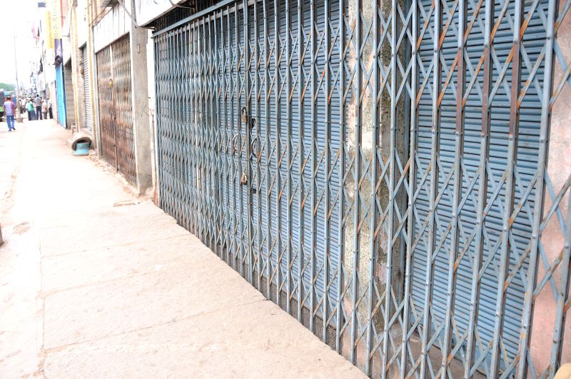 Shops remain closed in Bangalore as Kannada outfits call for a 12-hour strike against crime against women on July 31, 2014.
