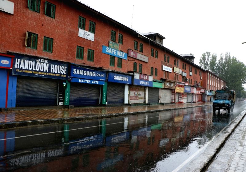 Shops remain closed in Srinagar as curfew continues in Kashmir valley on July 18, 2016.