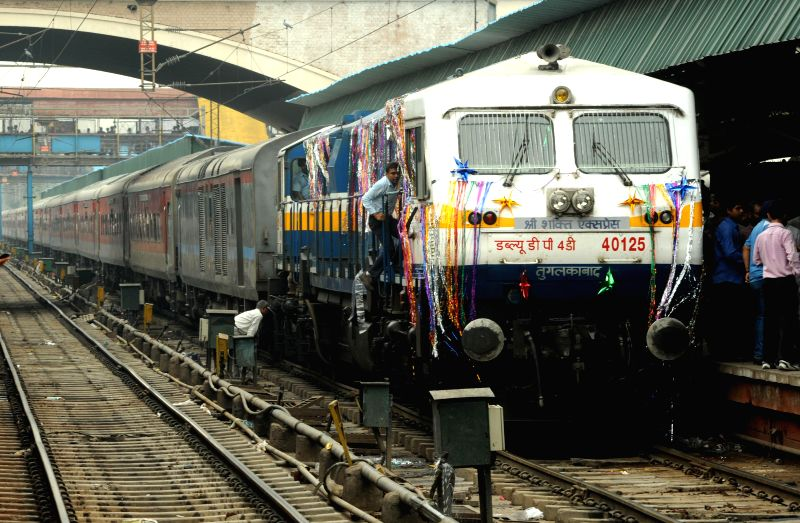 Shri Shakti Express chugs out of New Delhi railway station with devotees headed to Mata Vaishno Devi Shrine on July 14, 2014. The train will reach Mata Vaishno Devi railway station (Katra) at 5.10 am
