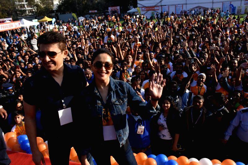 Shriram Nene and actress Madhuri Dixit Nene flags off the Half Marathon with over 4000 plus mumbaikar's, in Mumbai on Feb. 10, 2019. Also seen her husband Shriram Nene. - Madhuri Dixit Nene
