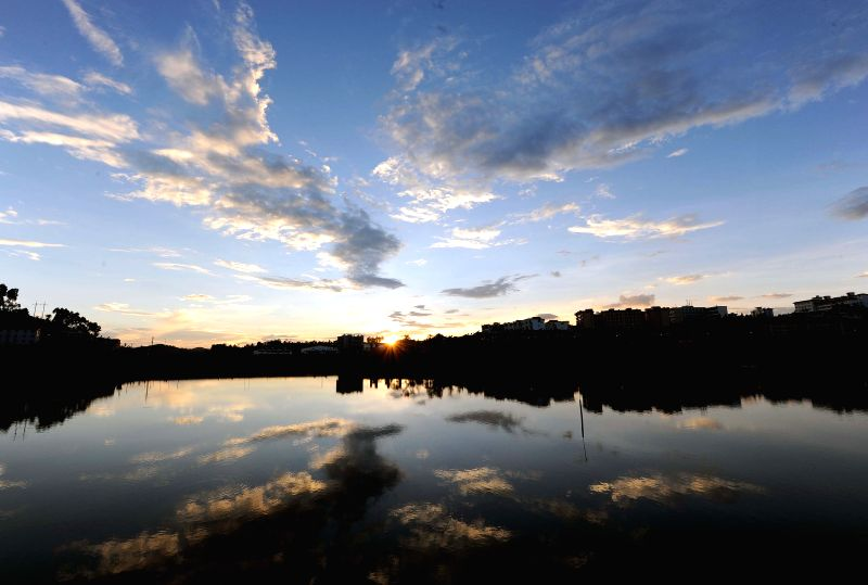 Photo taken on July 24, 2014 shows the evening scenery of Chamu River in Shuangbai County, southwest China's Yunnan Province, July 24, 2014.    (Xinhua/Yang ...