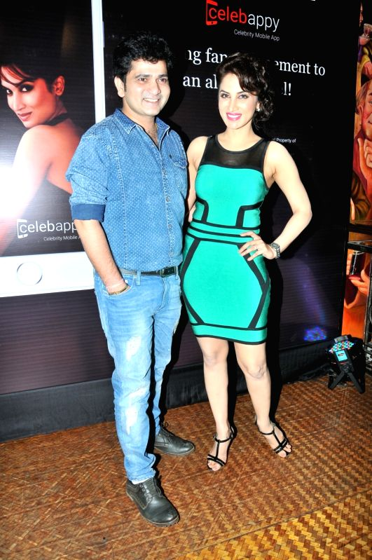 Shushant Shelar with Smita Gondkar during the launch of mobile application, Smita Gondkar app, in Mumbai, on July 22, 2016.