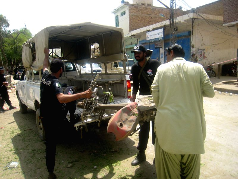 Security officials inspect the blast site in southwest Pakistan's Sibi on April 26, 2015. At least four people were killed and 18 others injured in a bomb blast in ...