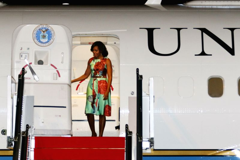 U.S. first lady Michelle Obama steps out of the plane at Siem Reap International Airport in Siem Reap, Cambodia, March 20, 2015. Michelle arrived here on Friday ...