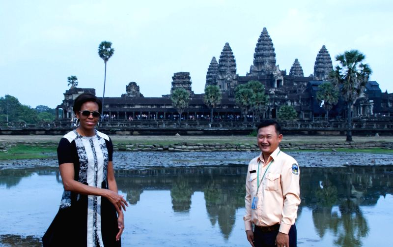 U.S. first lady Michelle Obama (L) poses for photos in front of the Angkor Wat Temple in Siem Reap province, Cambodia, March 21, 2015. U.S. first lady Michelle ...