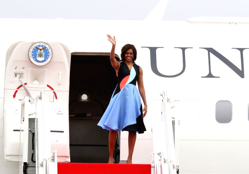 U.S. first lady Michelle Obama waves from the plane in Siem Reap, Cambodia, March 22, 2015. U.S. first lady Michelle Obama left here on Sunday for the United ...