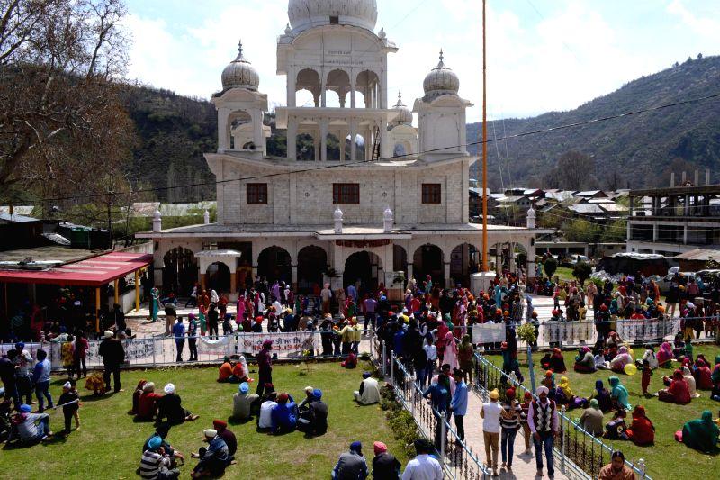 Sikh devotees devotees celebrate 'Baisakhi' at a Gurudwara in Srinagar on April 14, 2014.