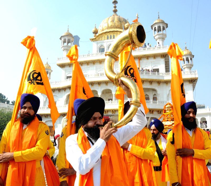 Sikh devotees taking part in a religious procession at the Golden Temple on the eve of 547th birth anniversary of Guru Nanak Dev in Amritsar on Nov 24, 2015. - Nanak Dev