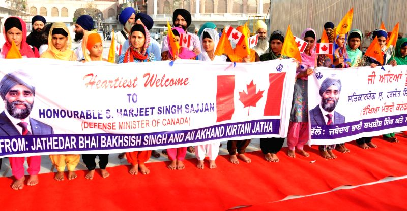 Sikh girls welcome Canadian Defence Minister Harjit Singh Sajjan at the Golden Temple in Amritsar on April 20, 2017. - Harjit Singh Sajjan