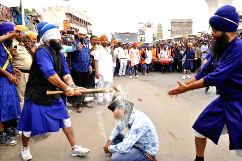 Sikh Nihangs display their `Gatka` skills ahead of 546 birth anniversary of Guru Nanak Dev the first Sikh Guru in Hyderabad on Nov 21, 2015. - Nanak Dev