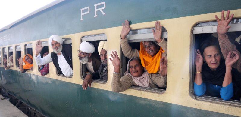 Sikh pilgrims leave for Gurdwara Nankana Sahib in Pakistan to celebrate the 547th birth anniversary of Guru Nanak Dev from Attari International Railway Station in Amritsar on Nov 20, 2015. - Nanak Dev