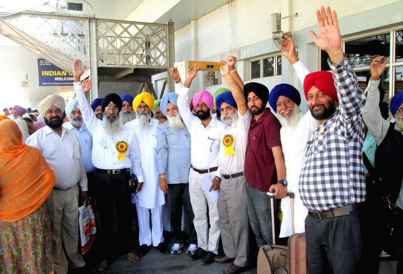 Sikh pilgrims of India leave for Pakistan to celebrate Baisakhi, in Attari on April 10, 2014.