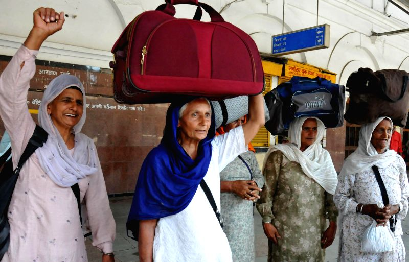 Sikh pilgrims of India leaving for Pakistan to celebrate Baisakhi wait for their train in Amritsar on April 10, 2014.