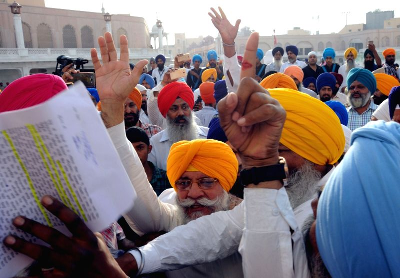 Sikh radicals shout pro-Khalistan slogans outside the venue of a programme organised by Shiromani Gurudwara Parbhandk Committee (SGPC) to felicitate  Canadian Defence Minister Harjit Singh ... - Harjit Singh Sajjan