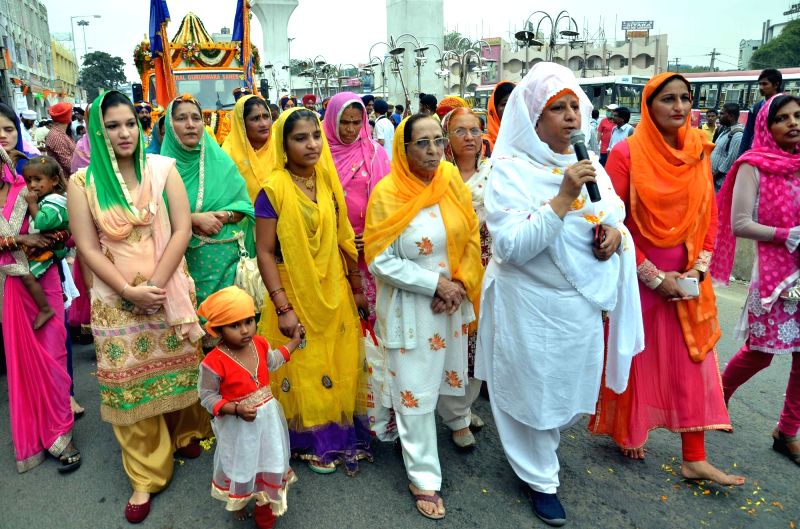Sikh women participate in `Nagar Kirtan` - a religious procession ahead of 546 birth anniversary of Guru Nanak Dev the first Sikh Guru in Hyderabad on Nov 21, 2015. - Nanak Dev