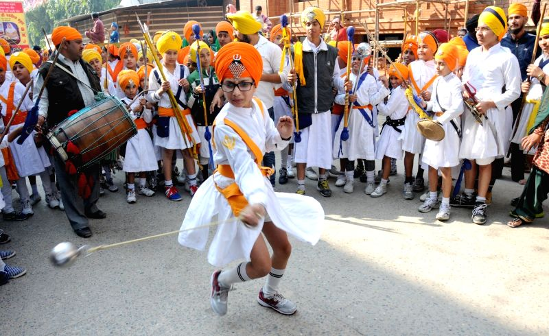 "Sikhs display their ""Gatka"" stills at the Golden Temple on the eve of Guru Nanak Jayanti in Amritsar"