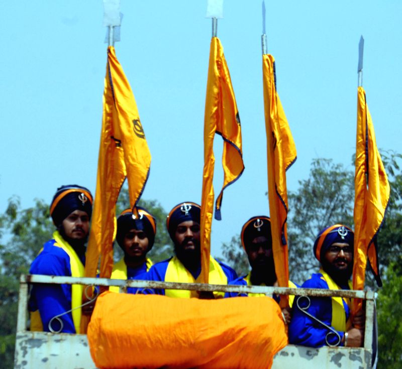 Sikhs during a procession organised on the eve of Baisakhi in Guwahati on April 13, 2014.