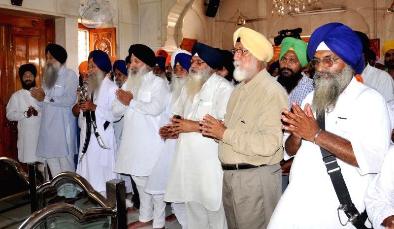 Sikhs led by Shiromani Gurdwara Prabandhak Committee (SGPC) member Hardeep Singh Mohali pray at Akal Takht to avert clash between SGPC and HSGPC in Amritsar on July 25, 2014. - Hardeep Singh Mohali