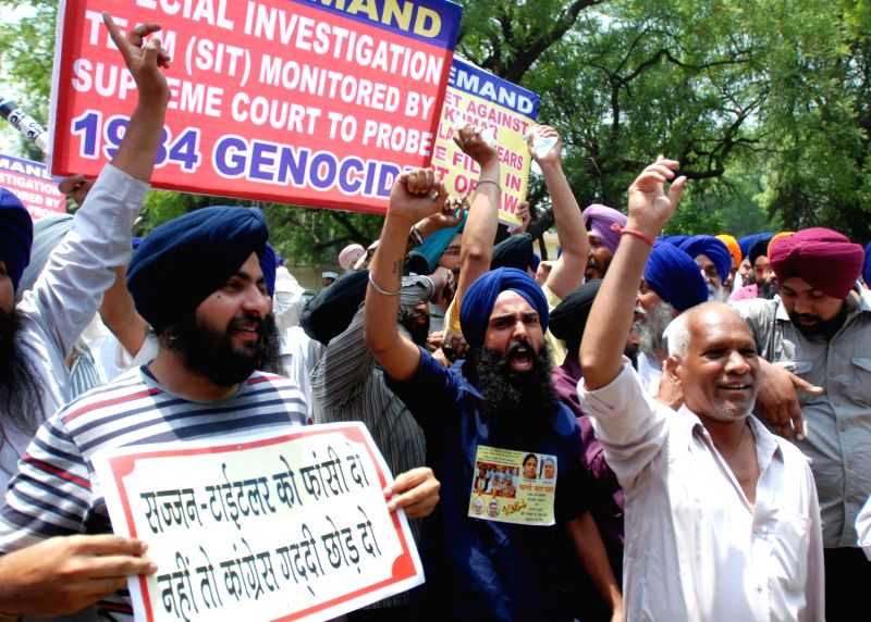 Sikhs raising slogans during a demonstration near Parliament in New Delhi on May 6, 2013 demanding punishment for Sajjan Kumar in 1984 riot case.