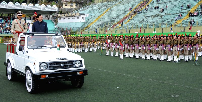Sikkim chief minister Pawan Chamling inspects guard of honor during a Police programme in Sikkim on Dec 1, 2015.